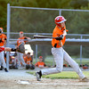 Altamont Post 512's Austin Rexroad takes a swing against Vandalia Post 95 at the District 23 tournament.