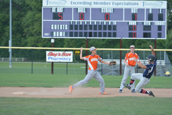 Newton Post 20 shortstop Brock Mammoser turns a double play on an assist from second baseman John Grunloh while Orient's Kyle Saillez slides to Mammoser's left during a 14-4 loss at the Fifth Division tournament in Bethalto.