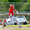Effingham Post 128's Cory Osborn swings at incoming pitch during the District 23 Junior Legion tournament.