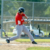 Effingham Post 120's Zac Bateman swings and connects against Salem Post 120.