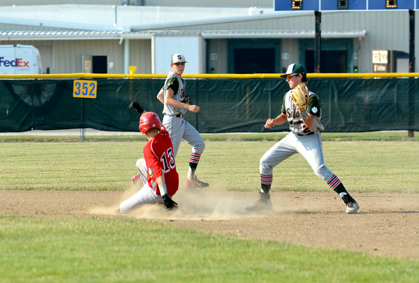 Effingham Post 120's Bryar Jansen slides into second base during a game against Salem Post 128.