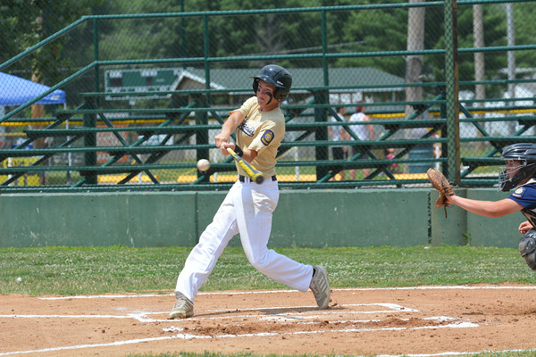 Teutopolis Post 924's Brock Mette swings and is about to connect on a double during the District 23 senior tournament against Robinson Post 69.
