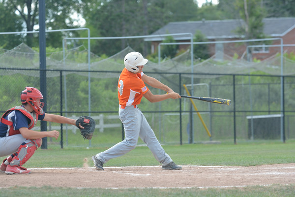 Newton Post 20's Luke Geier follows through on a swing that would connect for an RBI double against the Orient Miners at the Fifth Division tournament in Bethalto.
