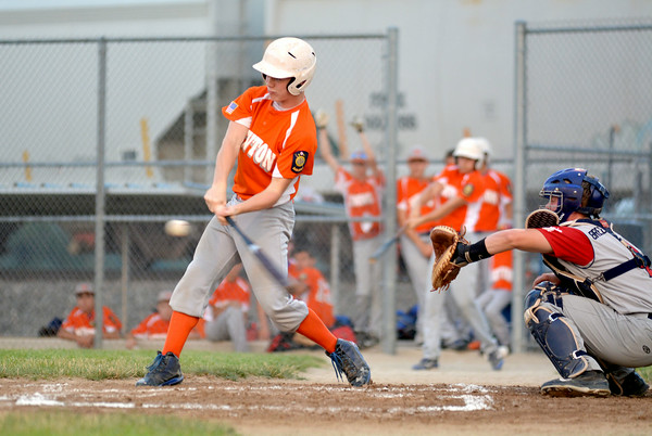 Newton Post 120's Mitch Bierman takes a cut during a game against Breese Post 252 Gray.