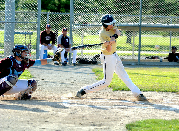 Teutopolis Post 924's Devin Smith takes a cut at a pitch against St. Joseph-Ogden's travel team.