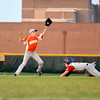 Newton Post 120's John Grunloh catches a throw while trying to catch a Breese Post 252 Gray runner stealing.