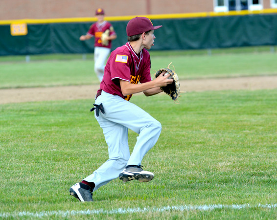 Dieterich Post 628 third baseman Bryce McClain gathers a ground ball and prepares to throw to first during the District 23 tournament against Effingham Post 120.