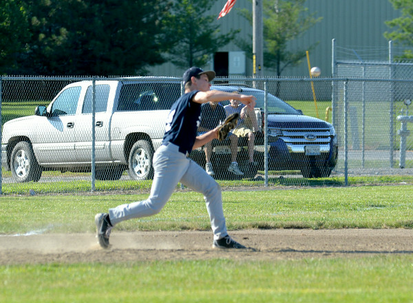 South Central Post 519 third baseman Trevor Markley throws to second base for a force out during the District 23 tournament against Teutopolis Post 924.