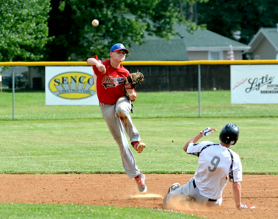 Effingham Post 120 Neil Williams tries to turn a double play against Olney Post 30 at the District 23 senior tournament in Robinson.