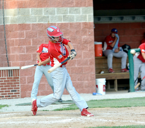 Effingham Post 120's Blake White swings at an incoming pitch during a junior game against Vandalia Post 95.