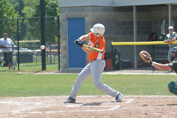 Newton Post 20's Mitch Jansen swings at an incoming pitch against Salem Post 128 in Bethalto and lifts a fly ball to left in a 12-1 loss.