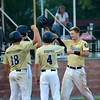 Teutopolis' Jordan Thoele (right) celebrates a home run at the Senior Legion Fifth Division Tournament in Carmi.