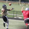 Lebanon's Elijah Rollins reaches back to make a catch in the Tigers' controlled practice against Cardinal Ritter on Thursday afternoon at Lebanon.