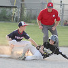 Lebanon's Cody Johnson slides in safely with a stolen base on Saturday against Evansville Highland.