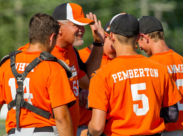 Altamont Post 512 head coach Alan Whitt (center) meets with his infield during a game against Teutopolis Post 924.