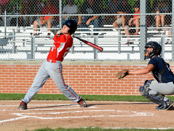 Effingham Post 120's Ryan Sandifer and South Central Post 519 catcher Trevor Markley watch a flyball off the bat of Sandifer during the district tournament at Paul Smith Field.