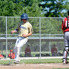 Teutopolis Post 924's Jacob Roepke (left) scores a run in the first inning behind Effingham Post 120 catcher Bryar Jansen.