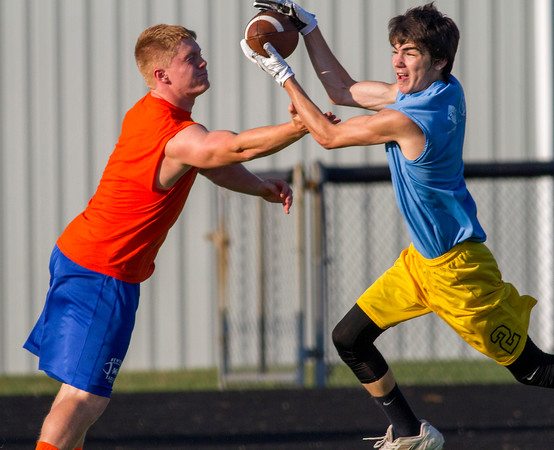Cumberland's Myles Gerhardt intercepts a pass intended for Newton's Mitch Bierman at a 7-on-7 event in Newton.