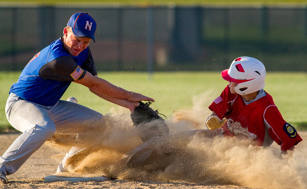 Newton Post 20 shortstop Chase Zumbahlen braces for Effingham Post 120's Kendall Ballman's slide at second base in the first inning.
