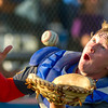 Newton Post 20 catcher Zak Finn makes a grab on a fly ball in foul territory during their game against Teutopolis Post 924.