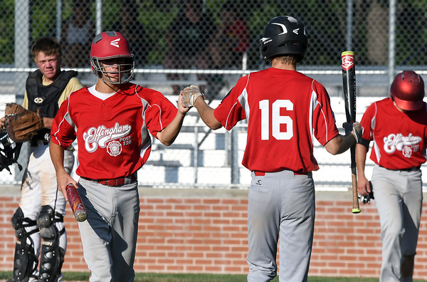 Effingham Post 120's Blake White (left) is congratulated by Bryar Jansen (right) after scoring during the first inning of a game against Teutopolis Post 924.<br /> Chet Piotrowski Jr./Piotrowski Studios