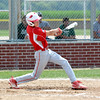 Effingham Post 120's Kendall Ballman follows through on a swing.