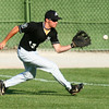 7-9-14<br /> American Legion baseball<br /> Logan Macaluso scoops up the ball in the outfield.<br /> Kelly Lafferty | Kokomo Tribune