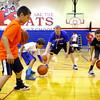 7-23-14 <br /> KHS boys basketball coach Matt Moore holding a basketball clinic for kids in grade 1-8. Cameryn Smith, Jon Callane, Hayden Smith and Jamari Patterson getting instruction from coach while doing a drill.<br /> Tim Bath | Kokomo Tribune