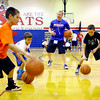 7-23-14 <br /> KHS boys basketball coach Matt Moore holding a basketball clinic for kids in grade 1-8. Cameryn Smith, Jon Callane and Hayden Smith getting instruction from coach while doing a drill.<br /> Tim Bath | Kokomo Tribune