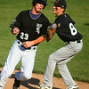 7-9-14<br /> American Legion baseball<br /> Cicero's #8 tags Isaac Turner and gets him out as he heads to third base.<br /> Kelly Lafferty | Kokomo Tribune