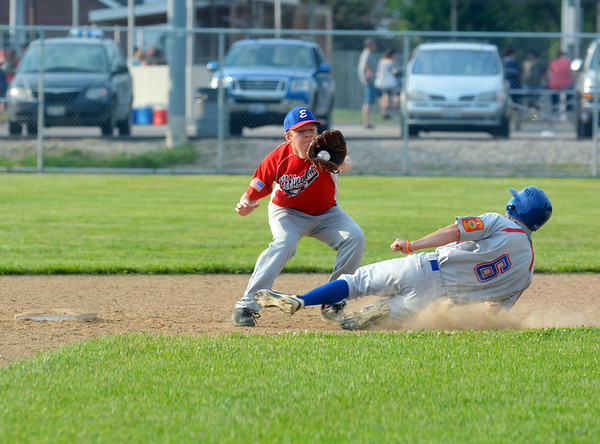 Effingham Post 120's Kenton Albin (Neoga) goes to apply a tag to Terre Haute Post 364's Jacob Johnson during the first inning of their American Legion baseball game at Paul Smith Field.