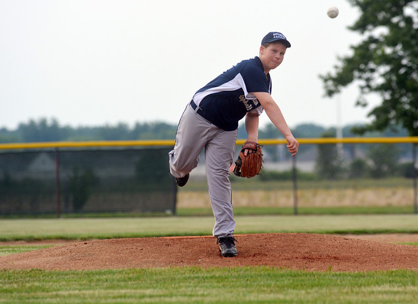Effingham Asphalt's Bryson Cutts delivers a pitch to a batter from JCR Carpentry at Evergreen Park as part of the Effingham Park District's Babe Ruth Prep League.