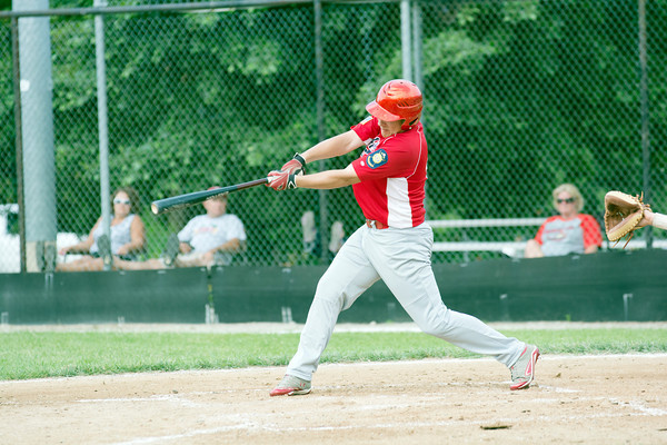 Effingham Post 120's Michael Woltman follows through on a swing during a game against Vandalia Post 95.