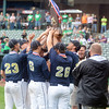 The Teutopolis Wooden Shoes host their third-place trophy in Class 2A baseball at Dozer Park in Peoria.