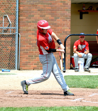 Effingham Post 120's Lane Koenig takes a cut at an incoming pitch during the first inning for a single against Shelby County Posts 289/611/725 during the junior Mattoon Firecracker Tournament at Lake Land College.