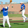Freeburg starting pitcher Milton Pinkston (middle) lifts his hands in the air after and shortstop Nick Yung (right) celebrates in mid air after recording the final out of a 3-1 win against Teutopolis in the Class 2A Sauget Super-Sectional.