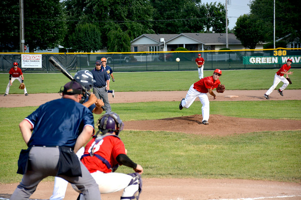 Toledo Post 764's Matt Kingery delivers a pitch to Danville Post 210's Devante Hicks and watches it fly toward home plate during the Mattoon Firecracker tournament at Mattoon High School.