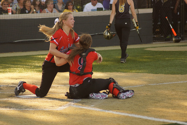 Altamont pitcher Diedre Ledbetter and catcher Lauren White (9) hug at home plate immediately following Altamont's 16-0 win over Camp Point Central at the Class 1A Super-Sectional held in Springfield.