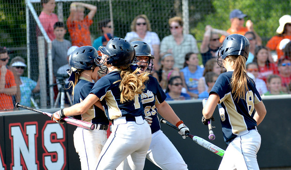 From left to right, Teutopolis' Madison Cowman, Kadi Borries, Allison Apke and Raegan Drees celebrate at home plate immediately following Anni Borries' two-run triple in the bottom of the sixth inning of a 2-1 win over Carterville.