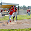 Effingham Post 120's Cory Osborn crosses home plate for Effingham's first run of 13 in a 13-0 win against Dieterich Post 628.