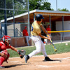 Teutopolis Post 924's Jordan Thoele swings and connects on a flyball during game one of their doubleheader with Effingham Post 120.