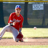 Effingham Post 120 shortstop Cory Osborn slides to the ground to field a ball during Newton Post 120's 12-6 loss.