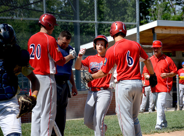 Effingham 120's Swayde Sanders (center) is congratulated at home plate by Alex Hoelscher (20, left) and Carter Hayes (6, right) after hitting a two-run home run during the first inning of their doubleheader with Teutopolis Post 924.