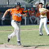 Teutopolis Post 924 pitcher Brock Bueker (right) throws to first base to get out Altamont Post 512's Kaleb Whitt during Teutopolis' 2-1 loss in junior Legion ball.