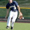 Teutopolis center fielder Tommy Flach races without his hat toward a ball that bounced past right fielder Bobby Wenthe in the Wooden Shoes' 3-1 loss against Freeburg at the Class 2A Sauget Super-Sectional.