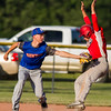 Newton Post 20's John Grunloh attempts to tag out Effingham Post 120's Tyler Zuber during a Senior Legion game in Newton.