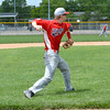 Effingham Post 120 third baseman Ethan Greene gathers a ground ball and throws out an unseen Robinson Post 69 runner in game one of a Senior Legion doubleheader.