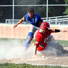 Effingham Post 120's Lane Koenig slides into home safely in front of Newton Post 20 catcher Tim Weber at Paul Smith Field.<br /> Chet Piotrowski Jr./Piotrowski Studios