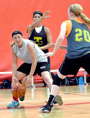 Effingham's Carsyn Fearday (left) dribbles between the defense of Teutopolis' Raegan Drees (center, background) and Jamie Sandschafer (right, foreground) at Effingham High School at the Southern Illinois Basketball Circuit.<br /> Chet Piotrowski Jr./Piotrowski Studios
