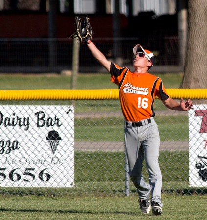 Altamont Post 512 center fielder Kevin Miller makes a grab during a game against Effingham. Miller and company kept Post 120 in check and came back to win 2-1 in the bottom of the seventh, with Miller scoring the walk-off run.